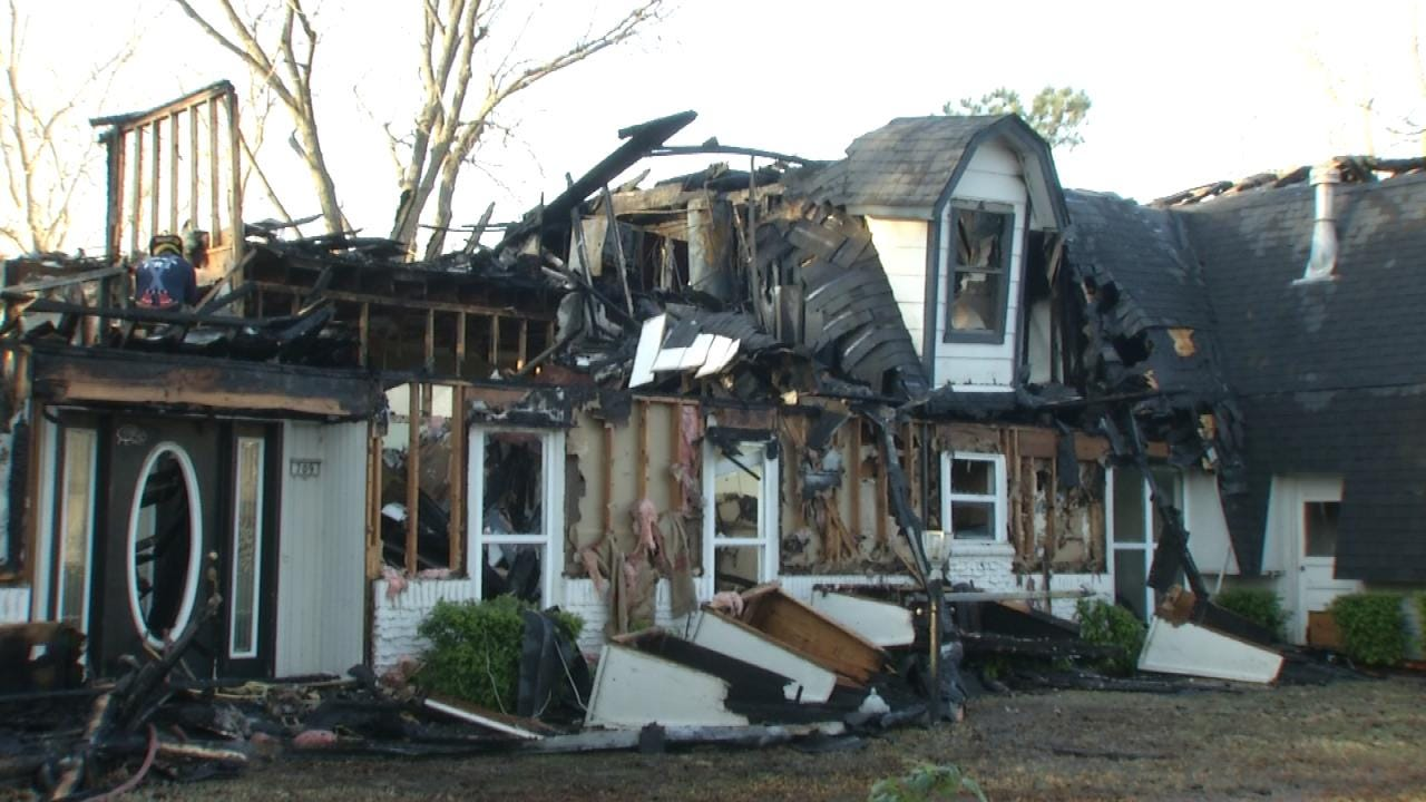 Investigators Work To Learn Cause Of Fire At Vacant Bever Home