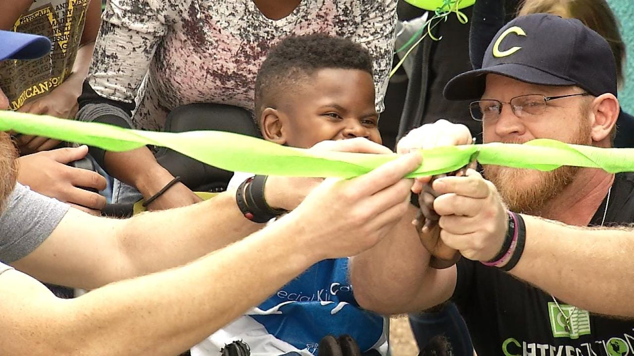 Special Kids Care Cuts Ribbon On New Special Needs Playground
