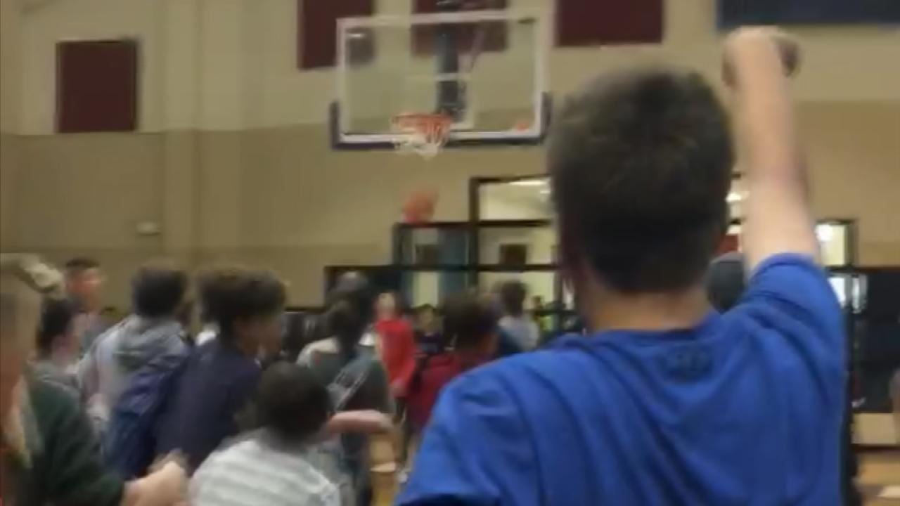 Bixby Middle School Special Olympian Nails Half-Court Shot