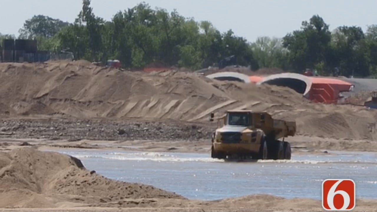 Construction Crew Races To Move Sand In Arkansas River Bed