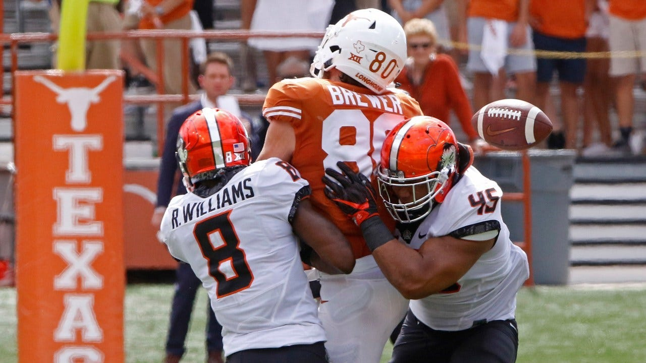 OT Interception Saves Cowboys, Beat Texas 13-10