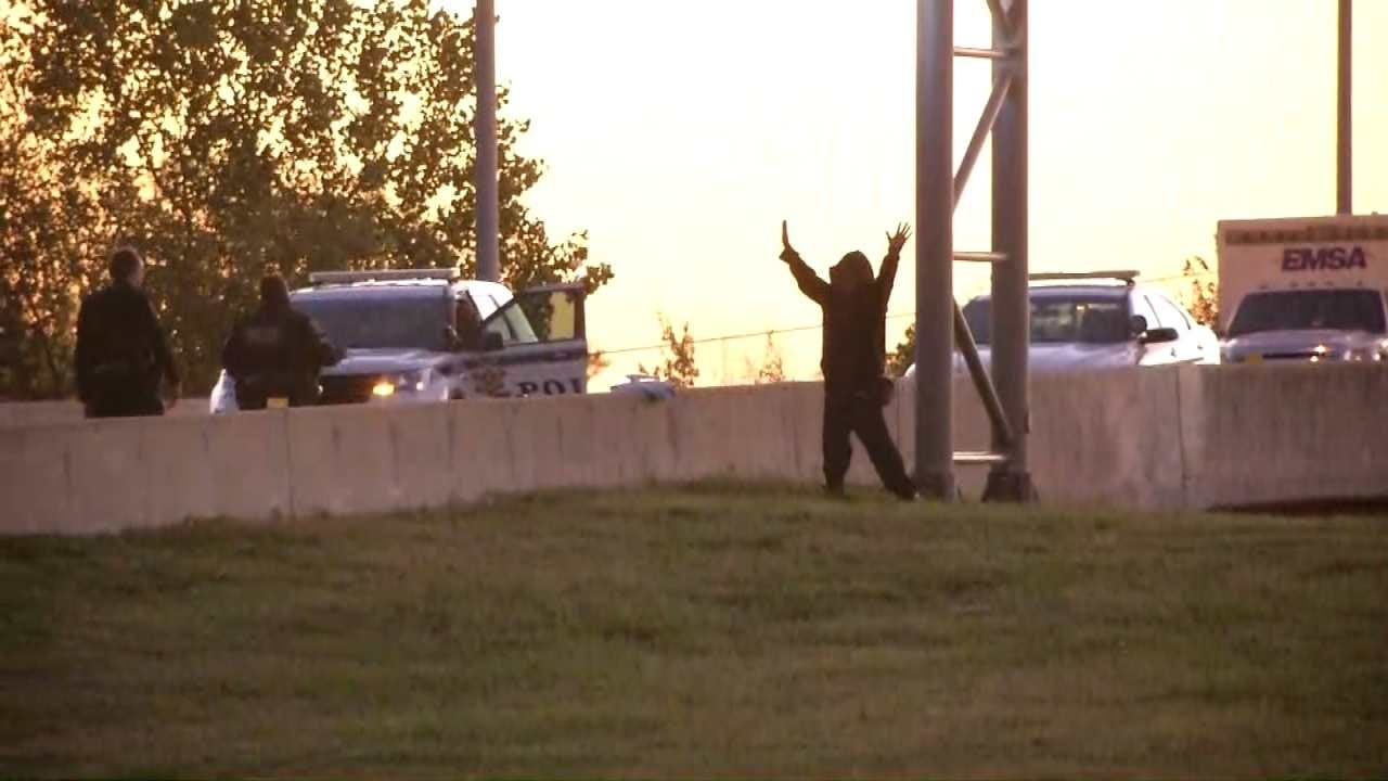Man On Tulsa Highway Sign Climbs Down After Almost 13 Hours