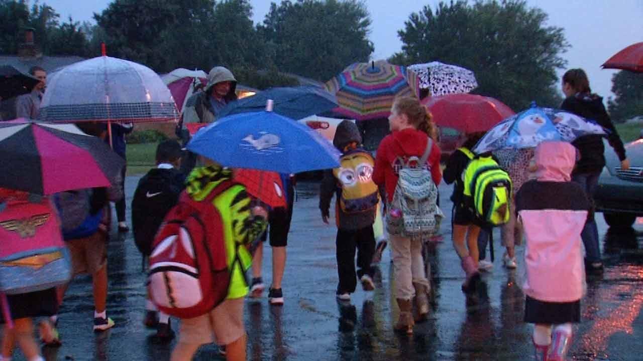 Despite Rain, Some Tulsa Students Celebrate National Walk To School Day