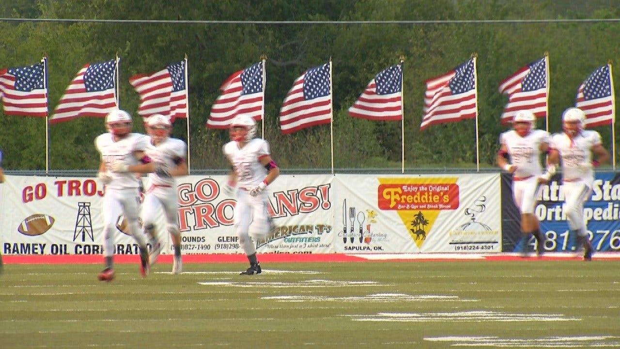 Kiefer Football Team Flies American Flags At Game