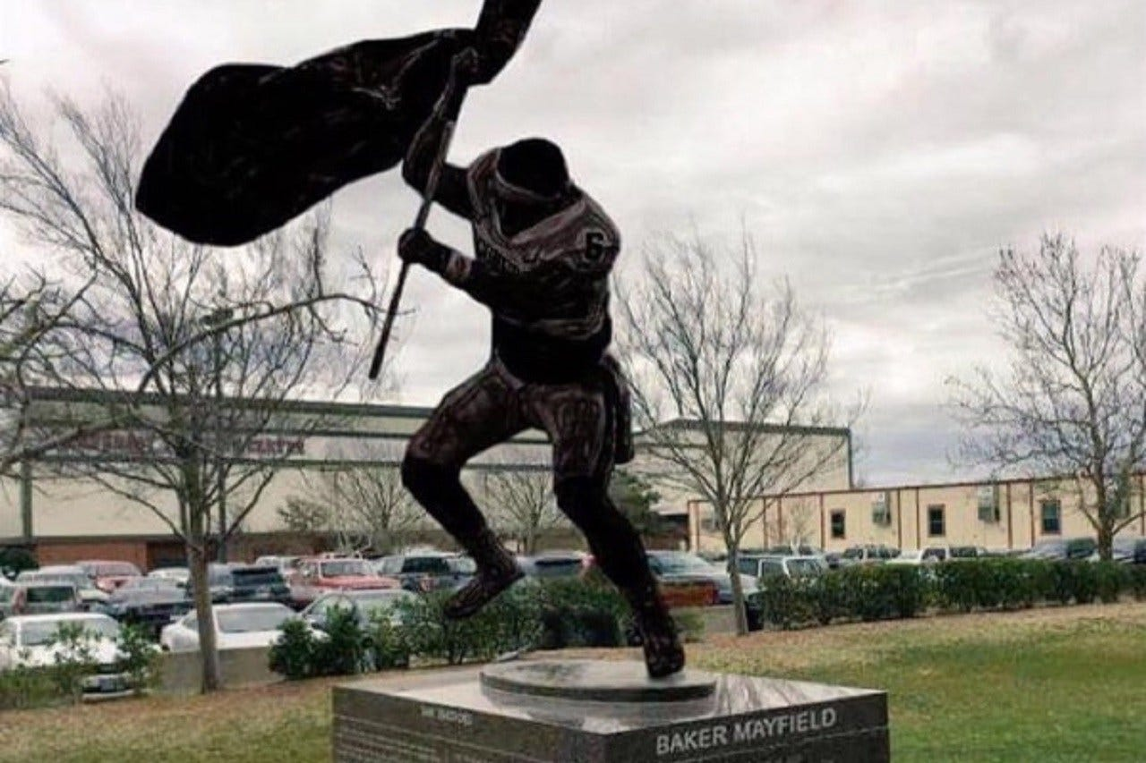 OU Fan Creates Fundraiser For Statue Of Baker Mayfield Planting Flag