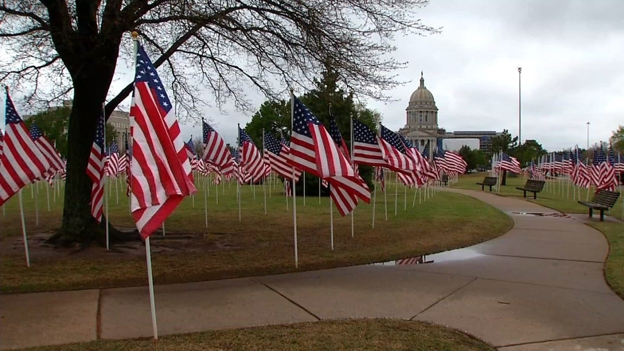 Flags At State Capitol Remember Child Abuse Deaths