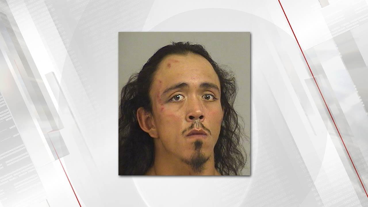 Tulsa Man Tries To Bite Officer During Arrest