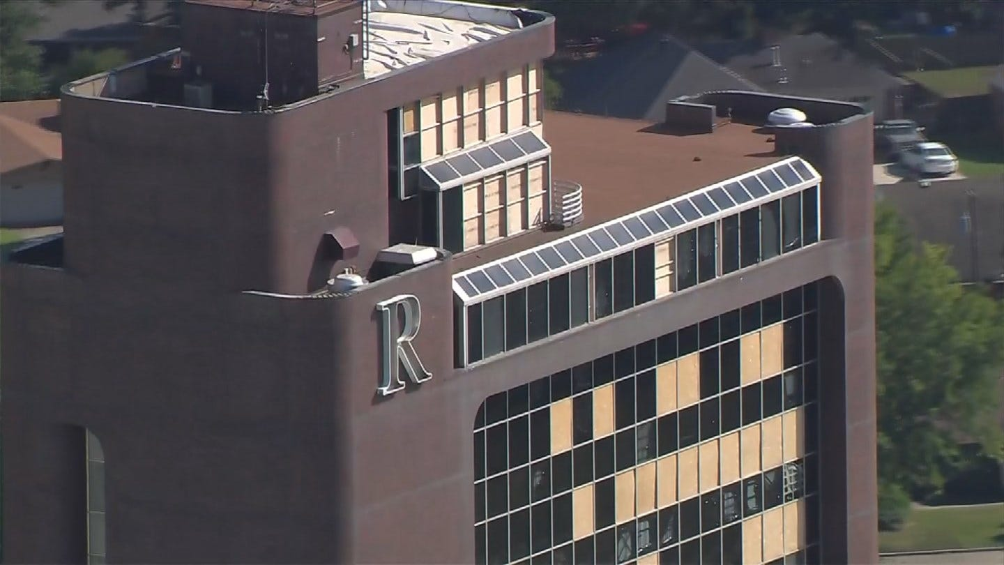 Workers Seen Replacing Windows At Remington Tower
