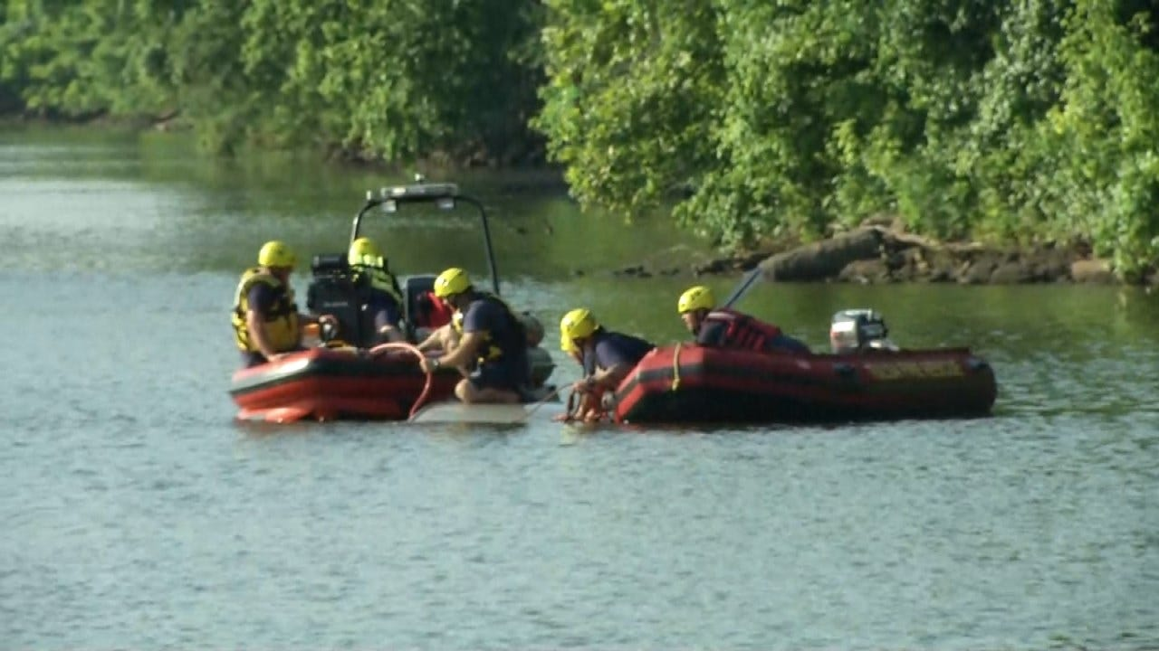 Tulsa Firefighters Work To Get Stolen Car In The Arkansas River To Shore