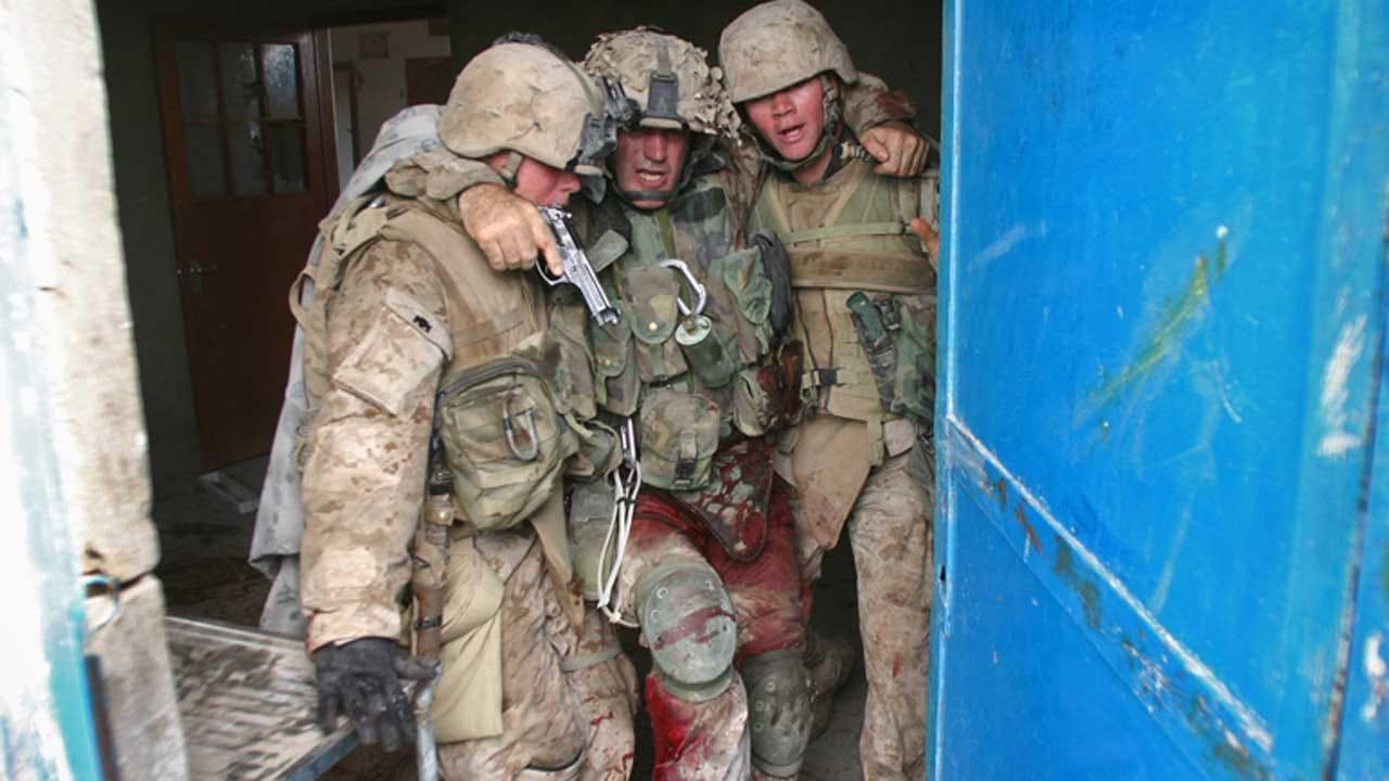 Marine Immortalized In Combat Photo Retires
