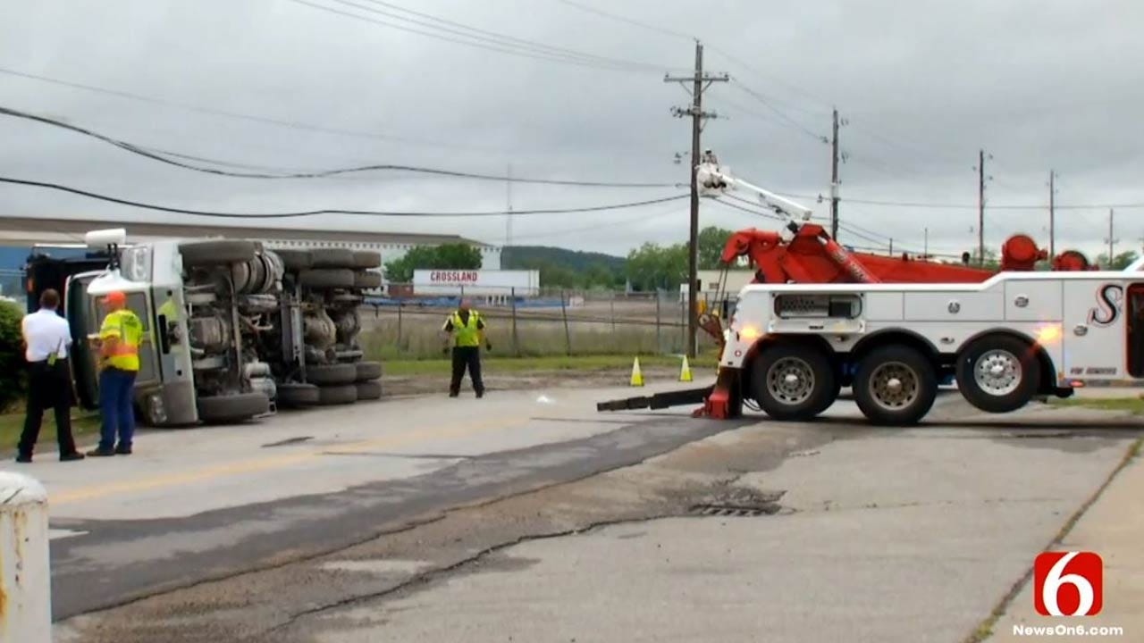 Dump Truck Hits Power Lines, Tips Over, Sand Springs Police Say
