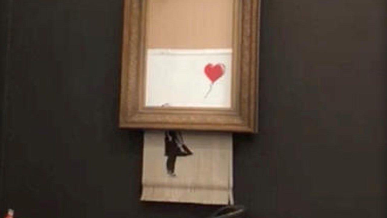 Banksy Artwork Self-Destructs Through Shredder Moment After $1.4 Million Sale
