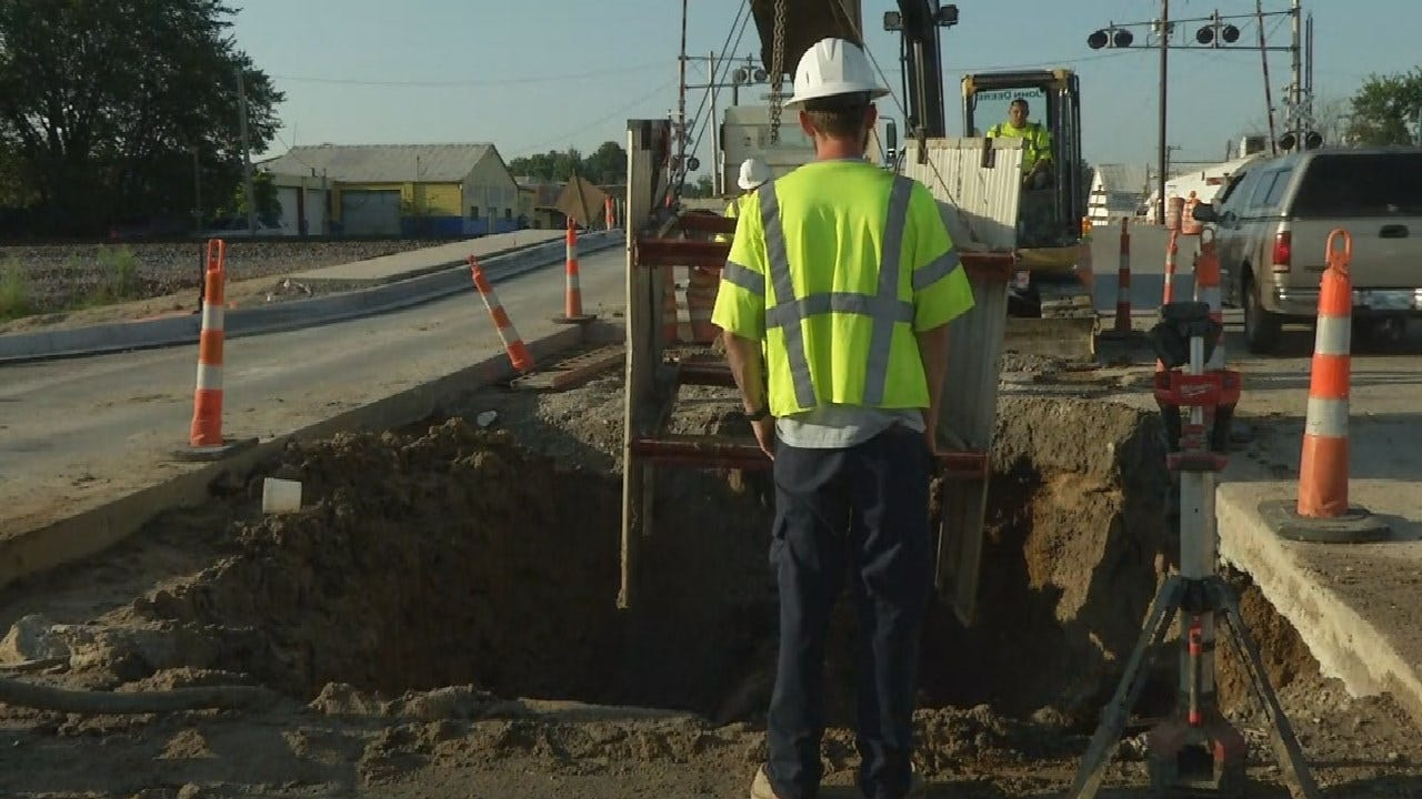 Tulsa Crews At Work Repairing Water Main Break From Pine To Archer