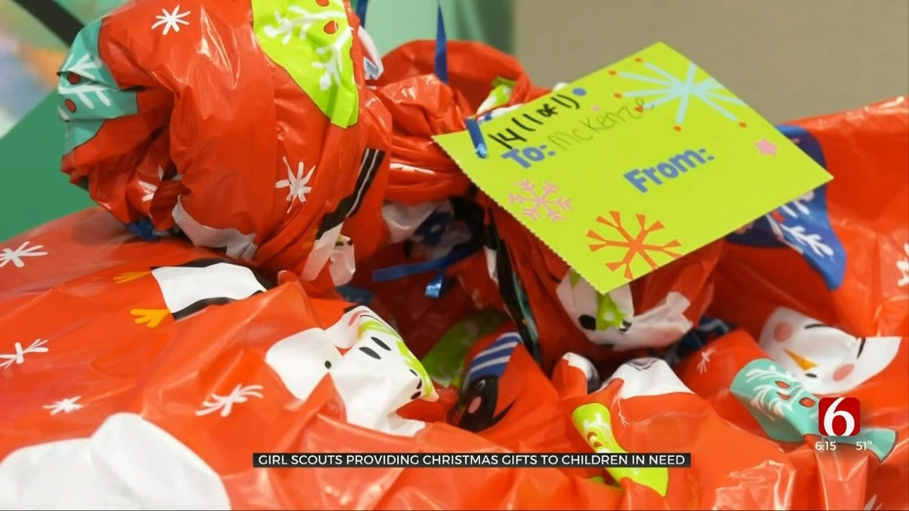 Trefoil Tree Event Provides Presents, Bikes For Girl Scouts, Siblings