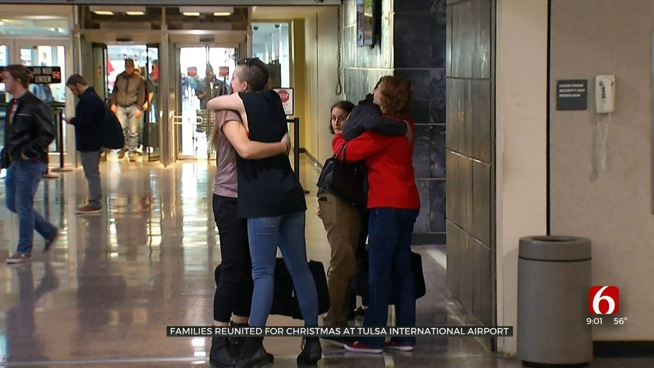 Families Reunite At Tulsa International Airport For On Christmas Eve
