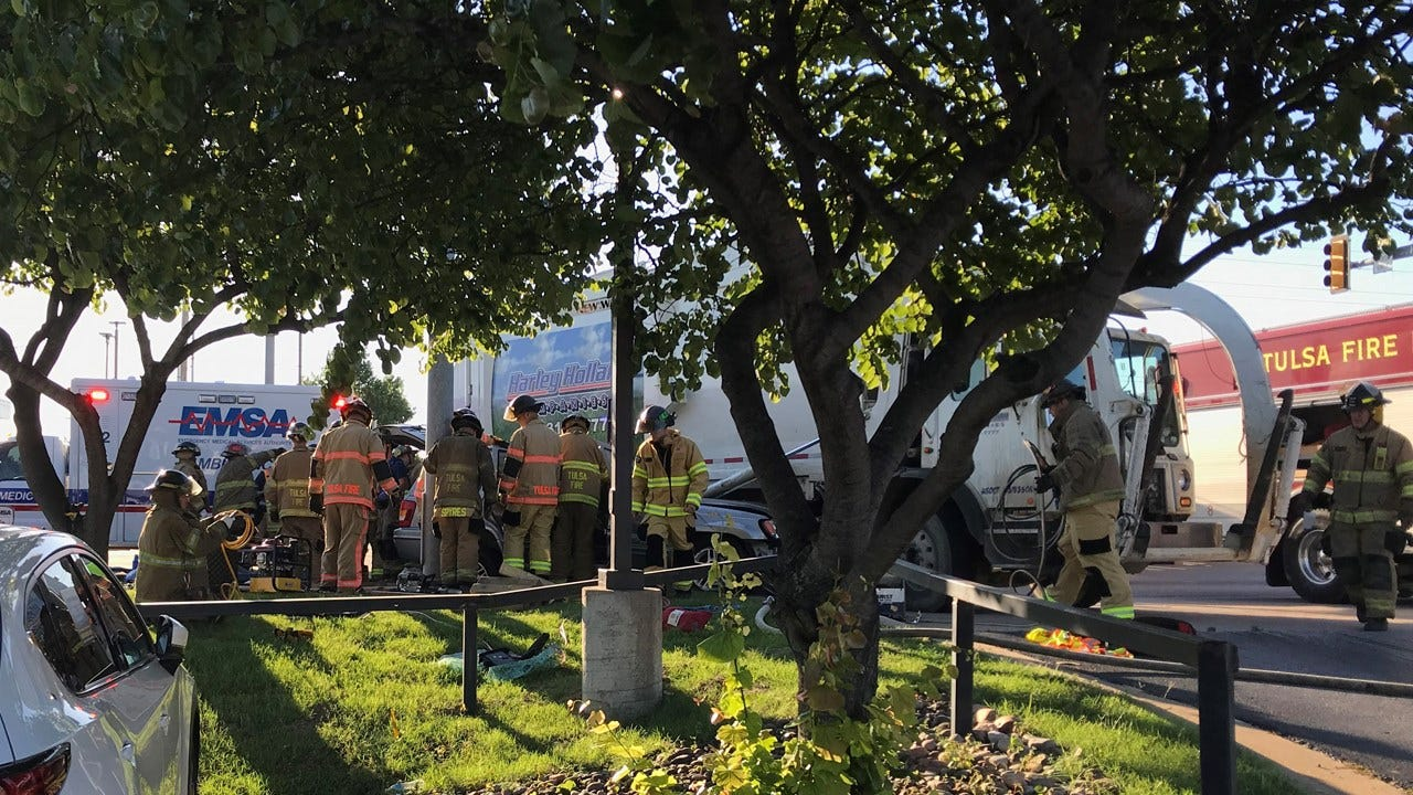 Tulsa Firefighters Free Woman Trapped In SUV After Hitting Trash Truck