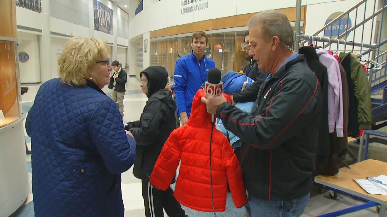 Basketball Fans Take Part In Trav's Coats For Kids Program