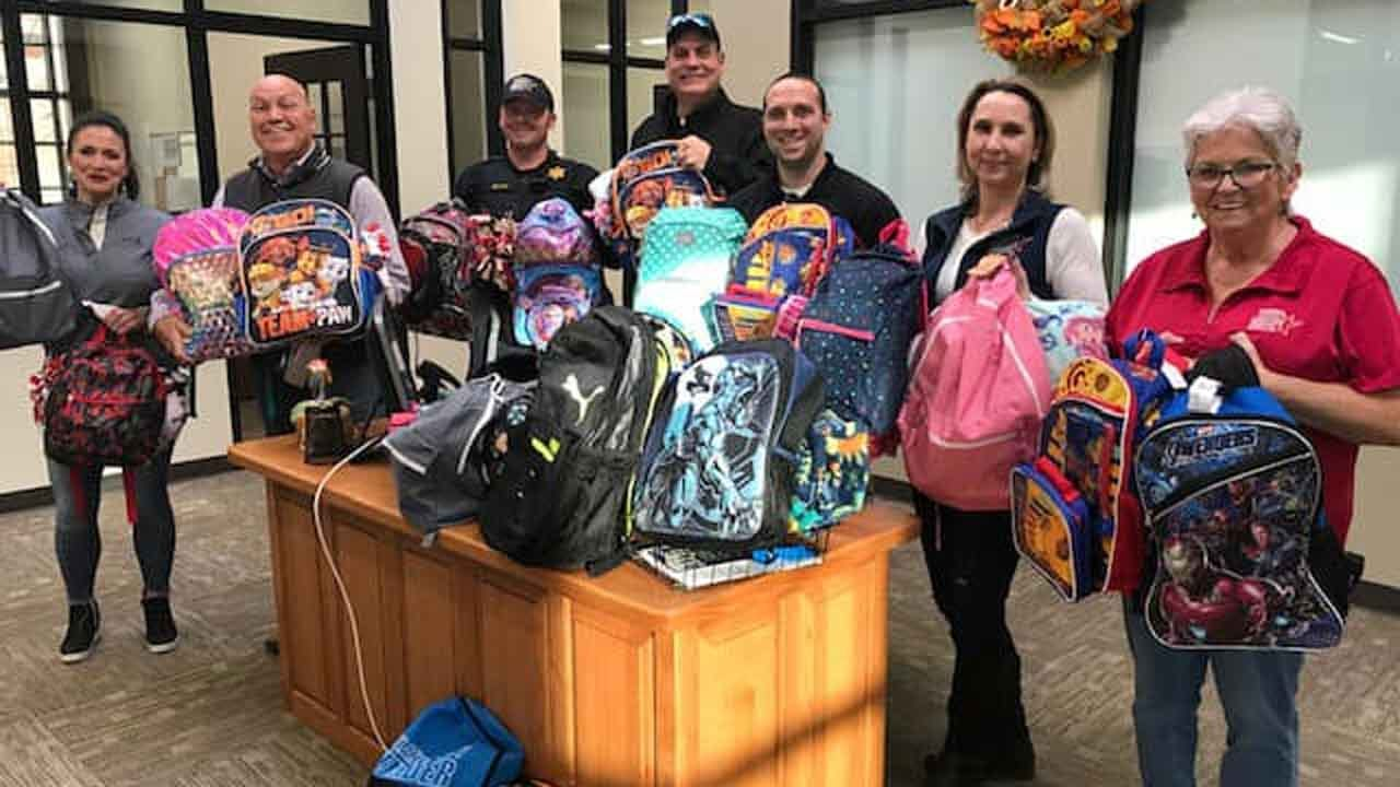 Church On The Move Delivers Backpacks To Rogers County Sheriff's Office