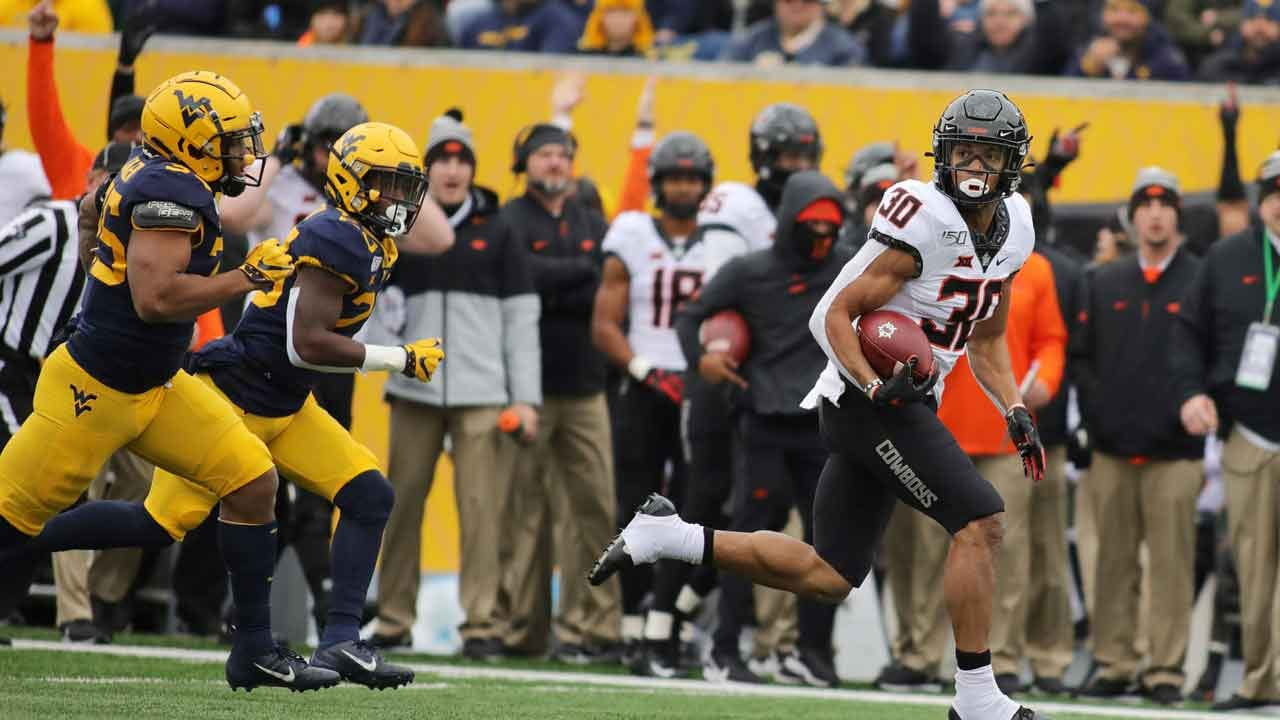Brown Leads No. 22 Oklahoma State Over WVU 20-13
