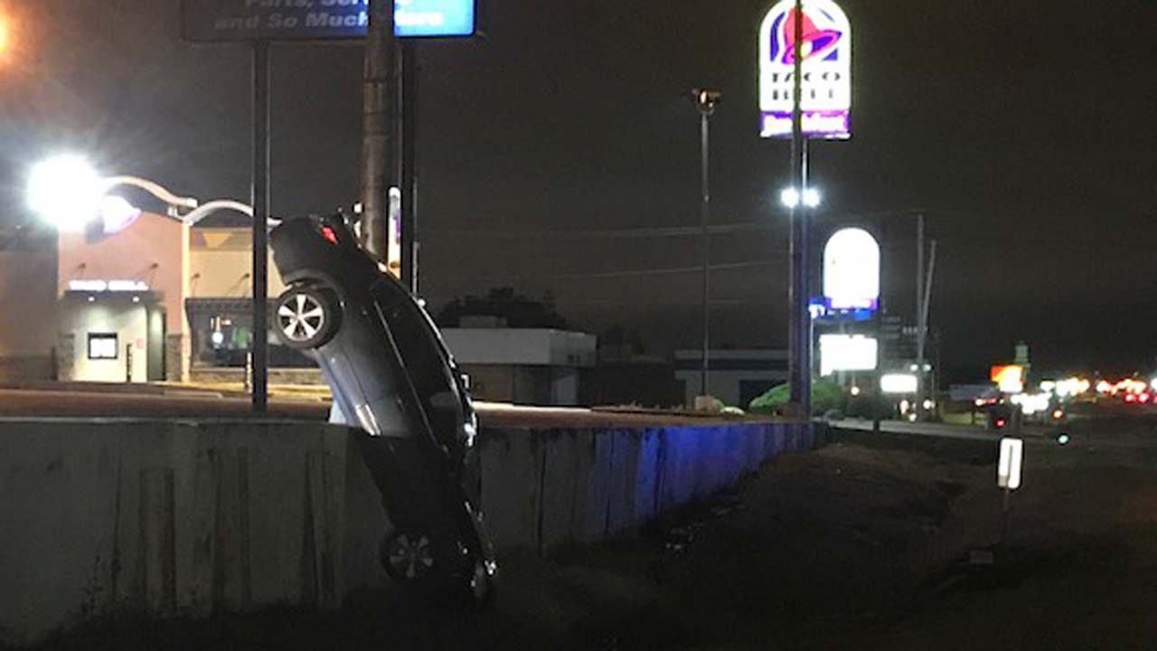 Car Hangs Off Raised Tulsa Parking Lot