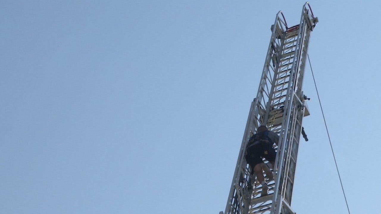 Tulsa Fire Cadets Test Skills By Climbing 85 Foot Ladder