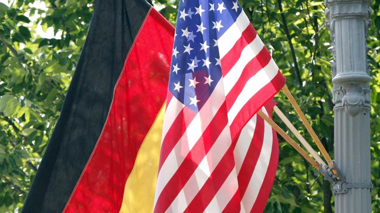 Photo of the U.S. and German flags.