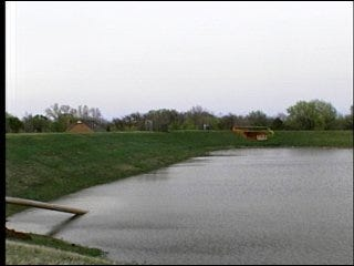 Water retention pond swells, 93 homes saved