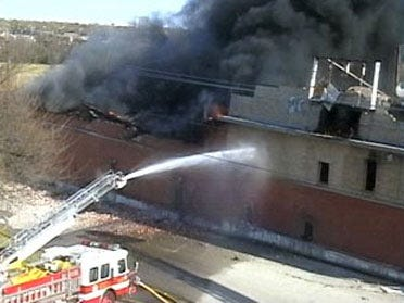 Abandoned downtown building burns
