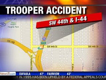 Trooper wrecks car, pinned for 30 minutes