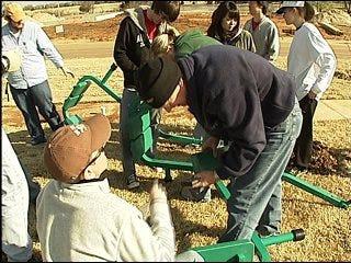 Volunteers build playground for community