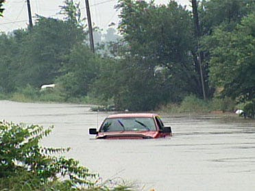 Family saved from rising floodwaters
