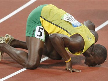 Bolt wins gold in 200