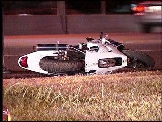 Motorcyclist wrecks bike, struck by car