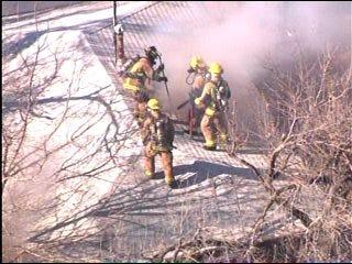 Firefighters Battle House Fire