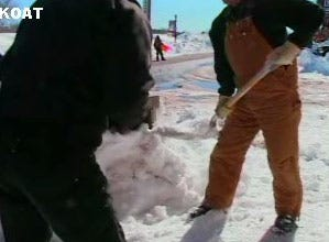 Volunteers help a snow-pounded town