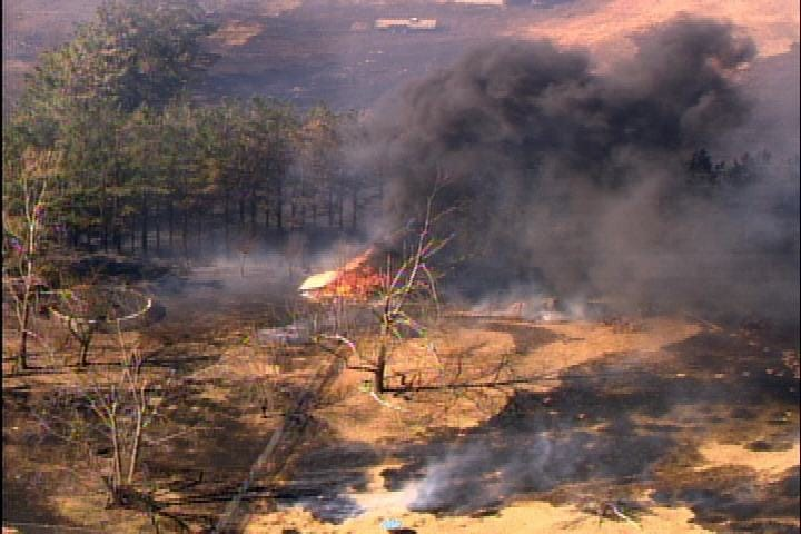 Wildfire threatens homes near Newalla
