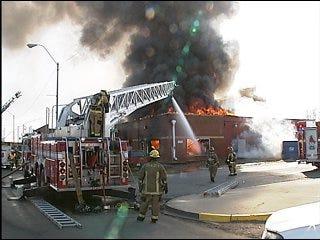 Firefighters battle four-alarm pet store blaze