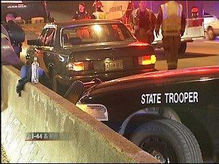 Woman pinned in highway crash
