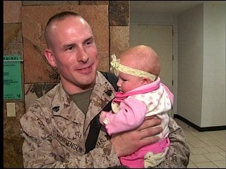 Marine held daughter for first time