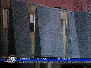Gunfire hits woman walking near apartment