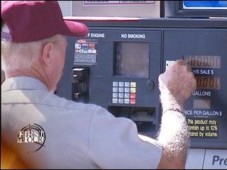 Gas pumps labeled with change