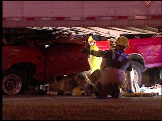 Man pinned under tractor-trailer taken to hospital