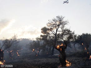 Fire causes mass evacuations from Greek resorts
