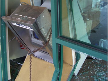 Men attempt to steal ATM machine from bank