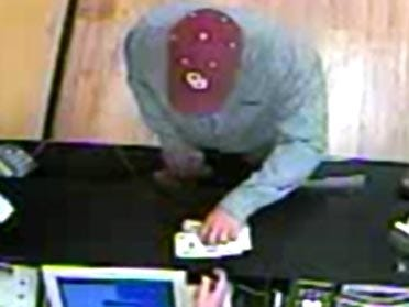Police search for July 4 robbery suspect