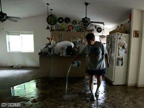 Water ebbs in Cedar Rapids, Iowa; other areas evacuated