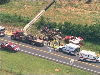 Driver pinned beneath overturned truck