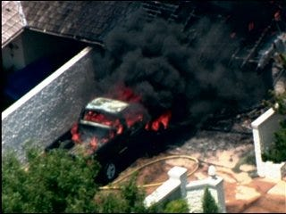 Blaze consumes garage of Norman house