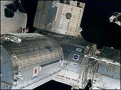 Shuttle Astronauts Prep Robotic Arm Use