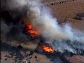 Fire scorches trees, grass near Stillwater